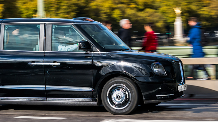 Electric TX5 London Black Taxi moving right to left