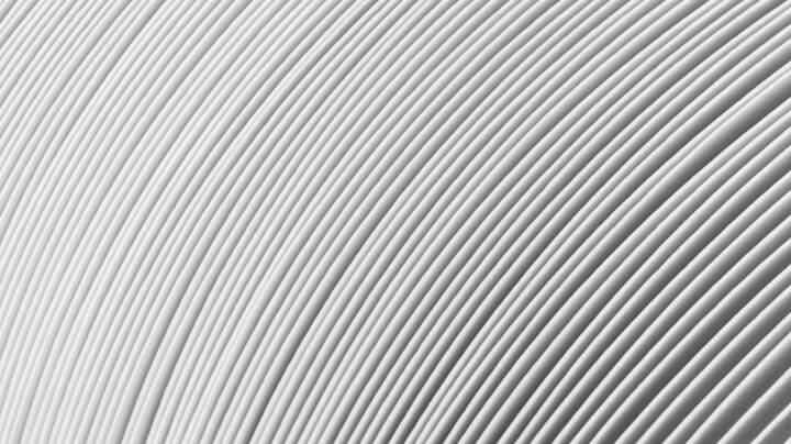 Extreme close-up of a stack of folded white paper produced by the pulp and paper industry.